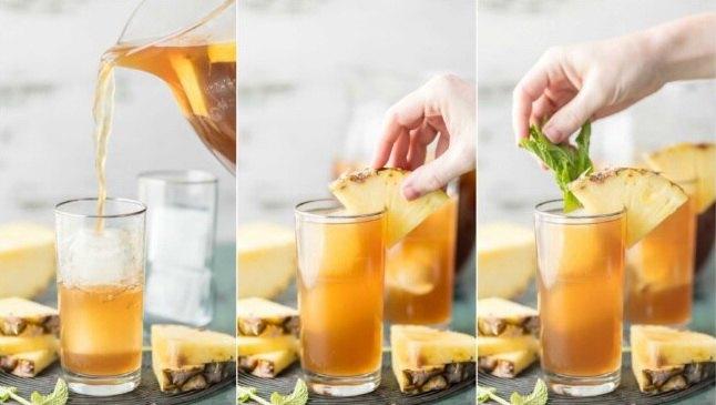 Холодный чай с соком ананаса и кубиками льда в стакане
